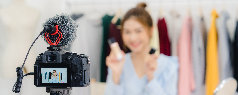 beauty-blogger-present-beauty-cosmetics-sitting-recording-video-camera